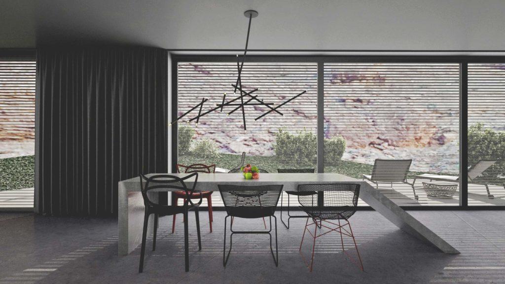Betónový stôl vychádzajúci z podlahy a rozličné stoličky