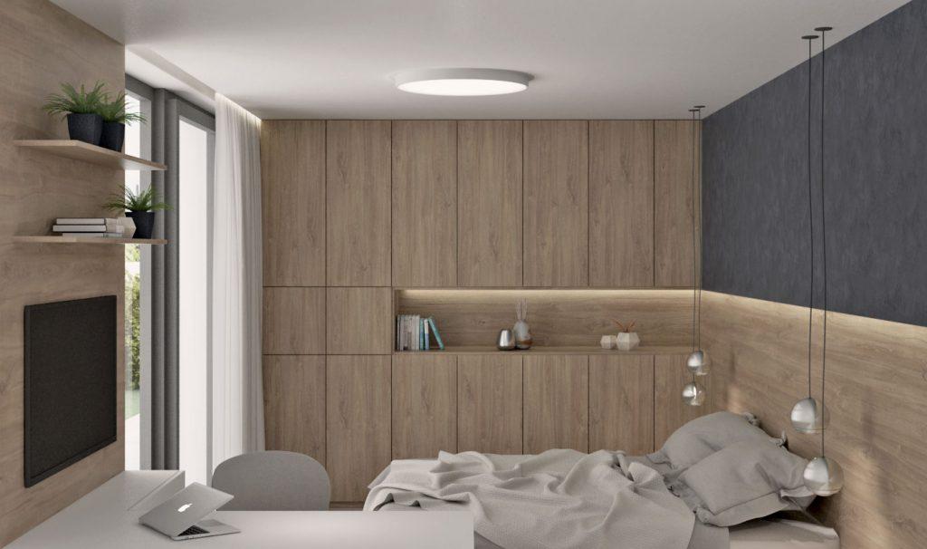 Drevená skriňa v spálni s prepojením v čele postele
