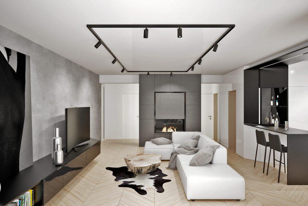 Obývačka bytu v čierno- bielych tónoch doplnená o útulnú drevenú podlahu