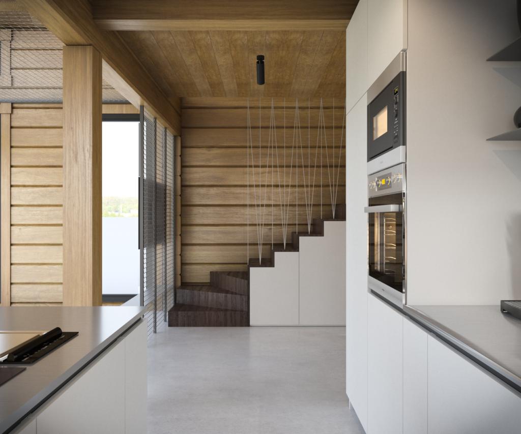 Pohľad z kuchyne na schodisko s úložným priestorom.